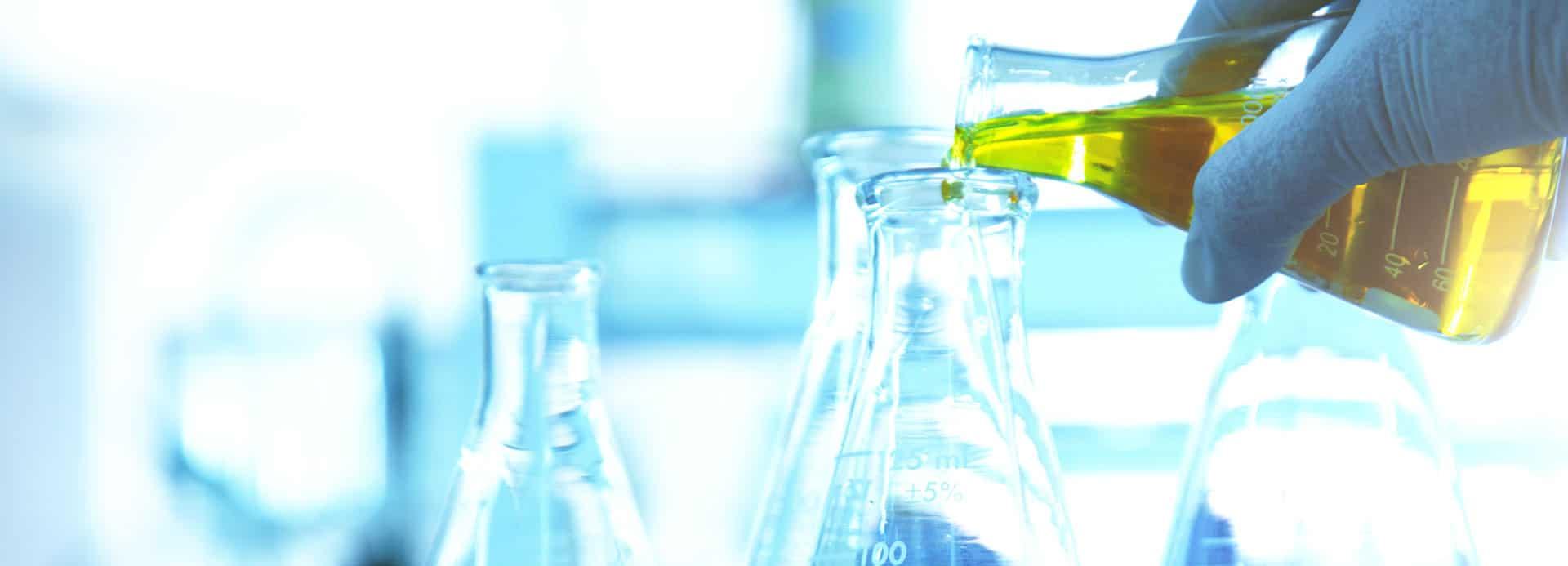 Chemist hand handling chemicals