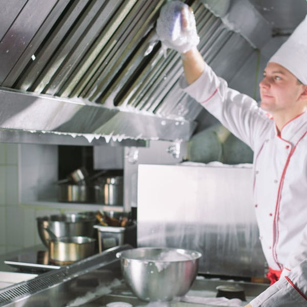 Chef-cleaning-filter-with-filter-cleaner-dalcon-hygiene