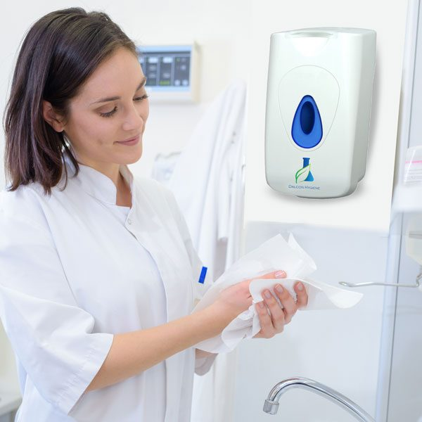 Young woman cleaning her hands with a wet wipe dispenser